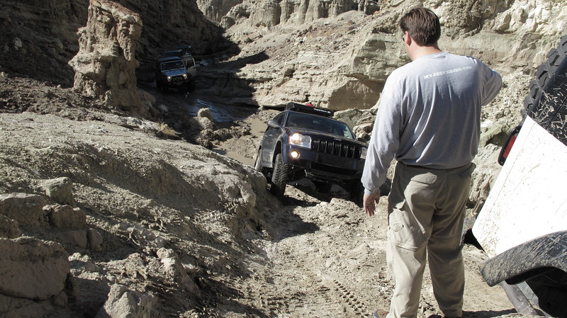 Mix clay, sand, and lots of water and watch the tires spin!<br /> Nathan watching Joe make repeated attempts to get the unlocked ZJ up the slippery slope