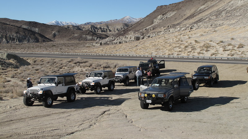 Airing down at the trail head.  5 Jeeps ( well, 4 plus one ZJ), two Land Cruisers