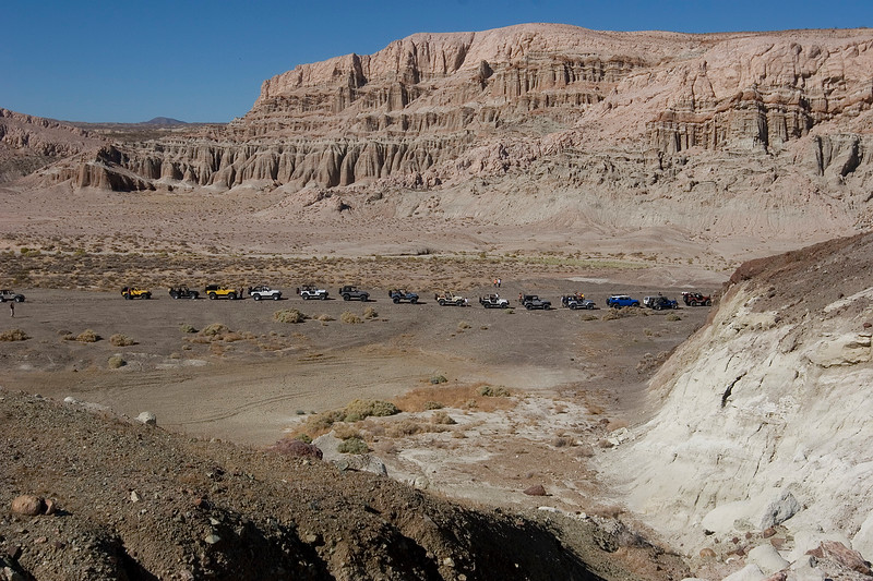 The line of Jeeps waiting for the gate to be unlocked.  Note the low area in the foreground.  This was a really cool dried mud bed.