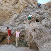 The kids had ample opportunities to climb the rocks in Painted Canyon