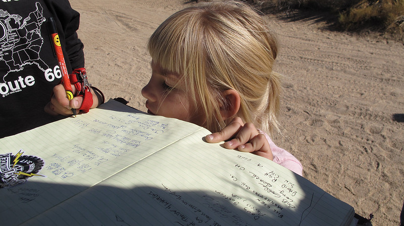 Megan signs the register provided by the Friends of the Mojave Trail, at the Mailbox