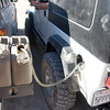 The LJ is a thirsty beast.  We went through one full tank, plus 7 additional gallons of fuel for the 200 miles of trail over three days.  Bruce's custom swing out bumper and fuel carriers made refilling very easy!