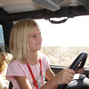 Megan loves driving, and at age 7, is pretty good at it.  Marni works the pedals.