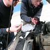 Paul Schuetz's RRC gives up an expansion tank in Mojave, right near a NAPA auto parts store.  English Andy (on the right) helps with repair.