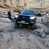 Chris's 4Runner on fat 33's just barely makes it through the first pinch-rock.