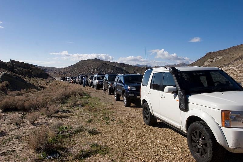 Airing down at the trail head to Nightmare Gulch.  15 trucks!