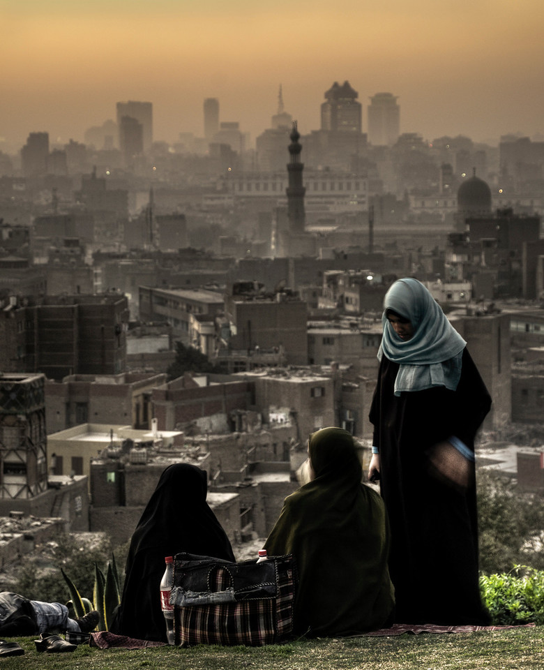 Local women take a breather from the intense noise and smog of this huge polluted city.  <br /> <br /> Al-Azhar Park, Cairo,Egypt 2010.