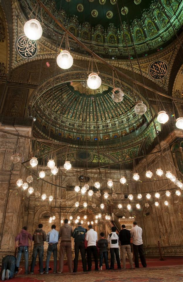 Men praying inside the Mohammed Ali Mosque.<br /> <br /> Cairo, Egypt, 2010.