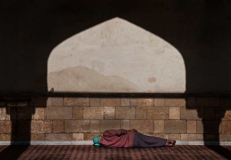 The Al-Azhar Mosque is a haven of peace and quiet, where many faithful come. Not just to pray, but also to escape the busy streets outside.   Cairo, Egypt, 2010.