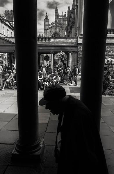 An elderly gentleman walking along the streets in the center of Bath.  Bath, England, 2018
