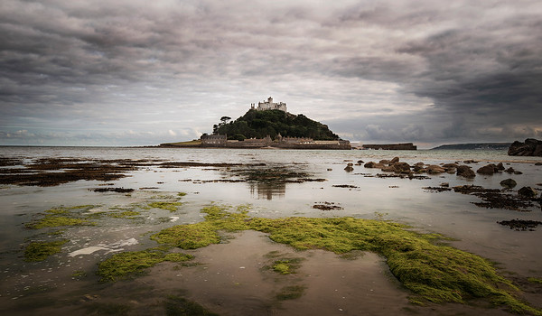 """During the 6th century, before a castle was built, according to legend, the island St. Michael's Mount sits upon was once home to an 18-foot giant named Cormoran, who lived in a cave with his ill-gotten treasures obtained by terrorizing local towns and villages. That is, until a young farmer's son named Jack took on this gigantic menace, who had an appetite for cattle and children, and killed him by trapping him in a concealed pit, bringing down his axe upon his head. When he returned home, the elders in the village gave him a hero's welcome, and henceforth, called him """"Jack the Giant Killer"""".  Cornwall, England, 2018"""