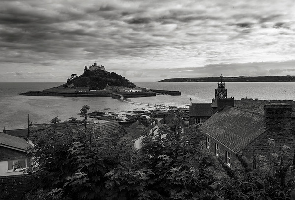 St Michael's Mount is a small tidal island in Mount's Bay, Cornwall, England, United Kingdom. The island is a civil parish and is linked to the town of Marazion by a man-made causeway of granite setts, passable between mid-tide and low water.  Marazion, Cornwal, England, 2018.