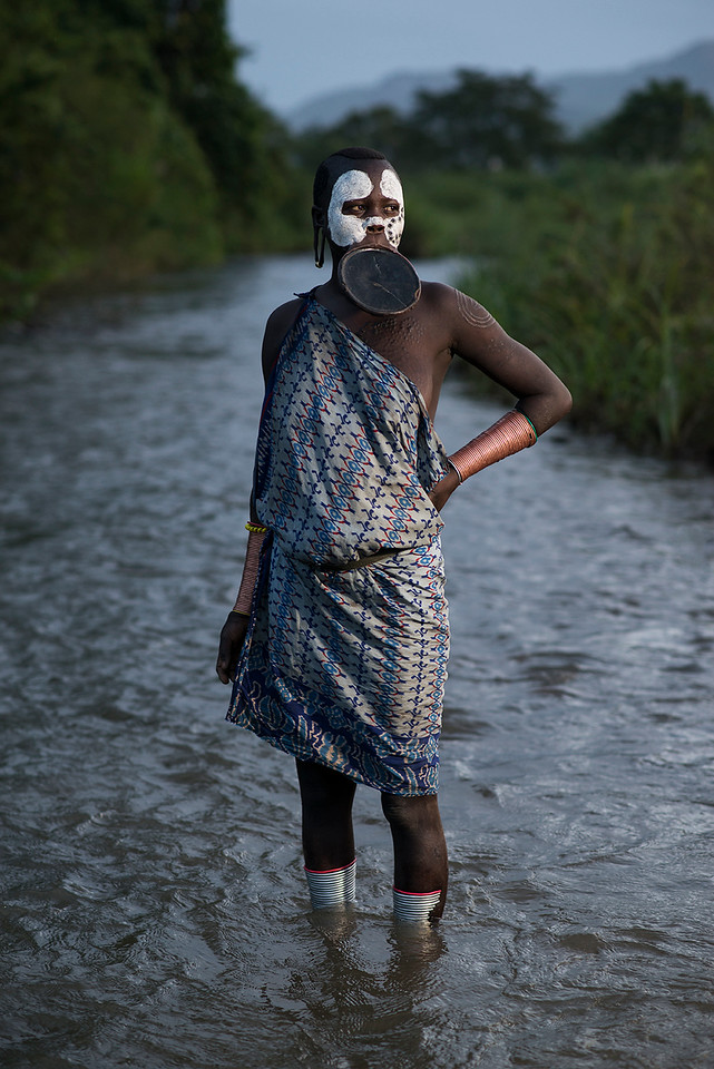 A Suri woman wearing the traditional lip plate.<br /> <br /> Southern Ethiopia, 2017