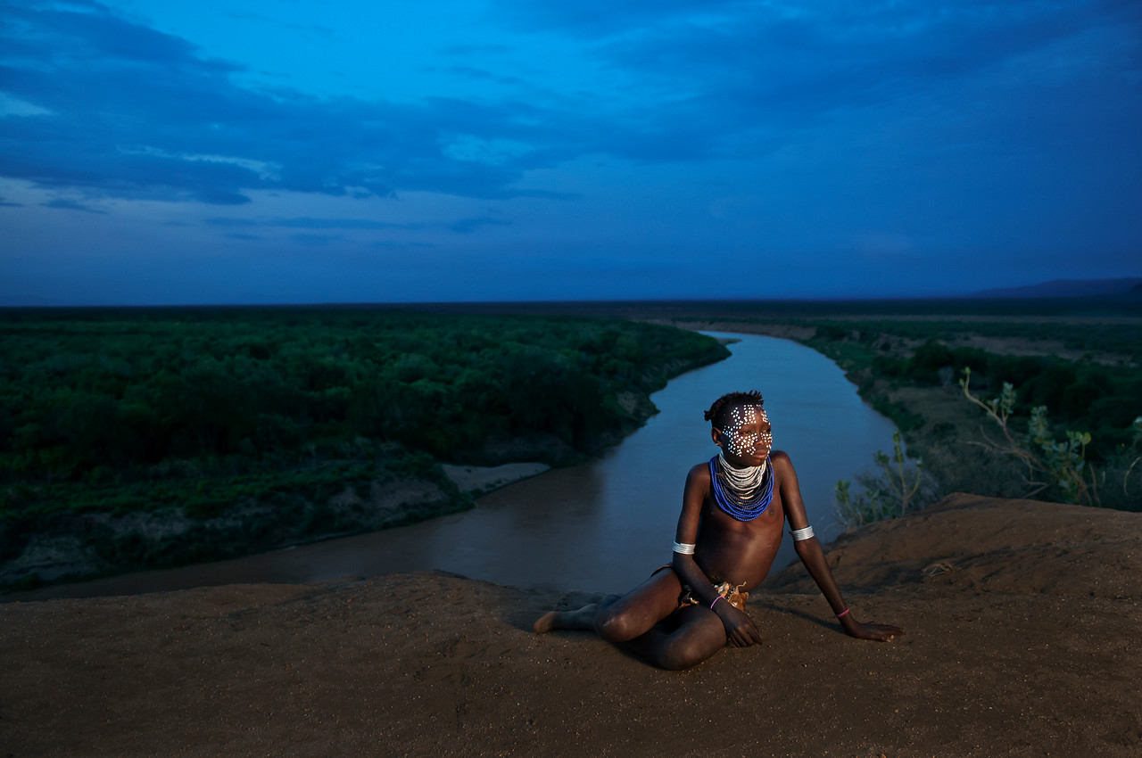 This is Gubi, a young girl from from the village of Kolcho, home to the Karo people. Kolcho village is situated on a Plateau overlooking the Stunning Omo River, an important source of water for many tribes and home to many crocodiles. <br /> <br /> Omo valley, south Ethiopia, 2013.