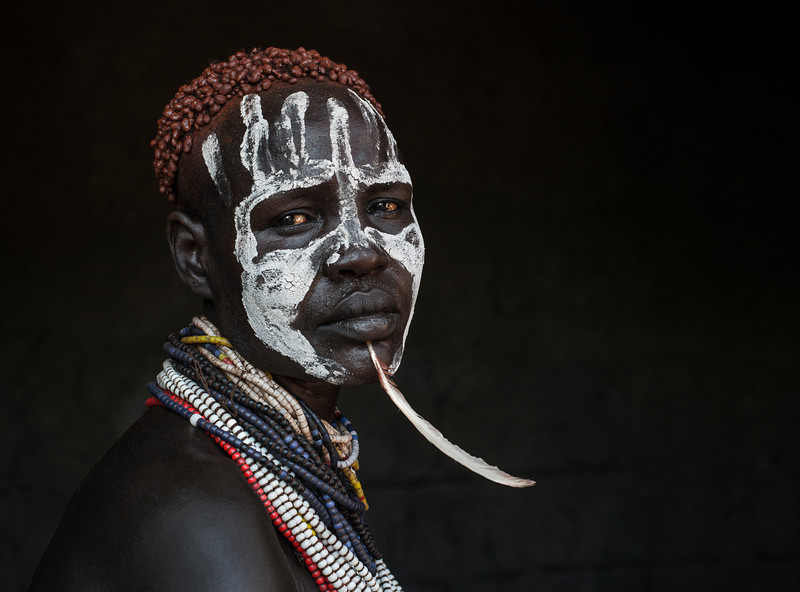 The Karo tribe use red ochre and white chalk to create intricate designs on their faces and bodies <br /> <br /> Both sexes do it as a way to be more visually appealing and attractive, while looking intimidating to rivals.<br /> <br /> Omo Valley, Ethiopia, 2017