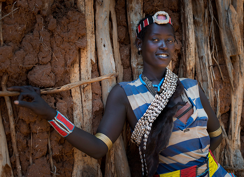A young Bena woman in a market in Key Afer.<br /> <br /> Key Afer, Omo Valley, Ethiopia, 2017.