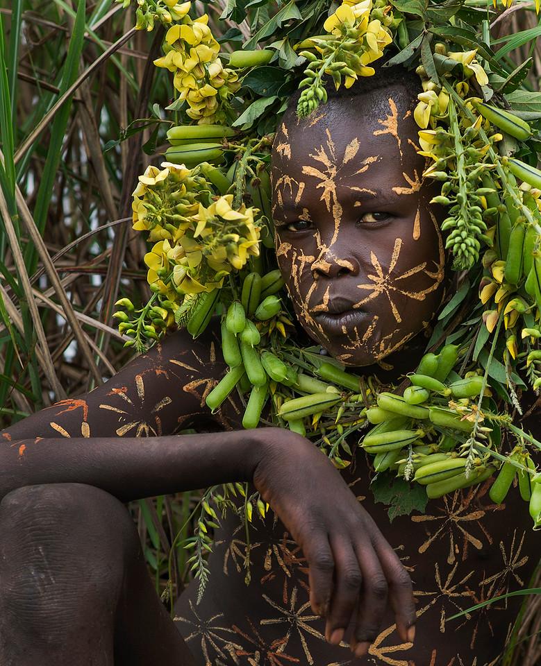 Portrait of a Suri boy.with body paint and decoration.<br /> <br /> Suri, Ethiopia, 2017