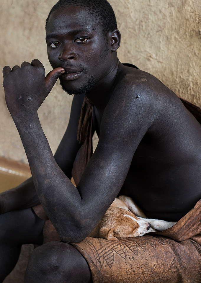 A nyangatom man with his pet dog.<br /> <br /> Omo Valley, Ethiopia, 2017