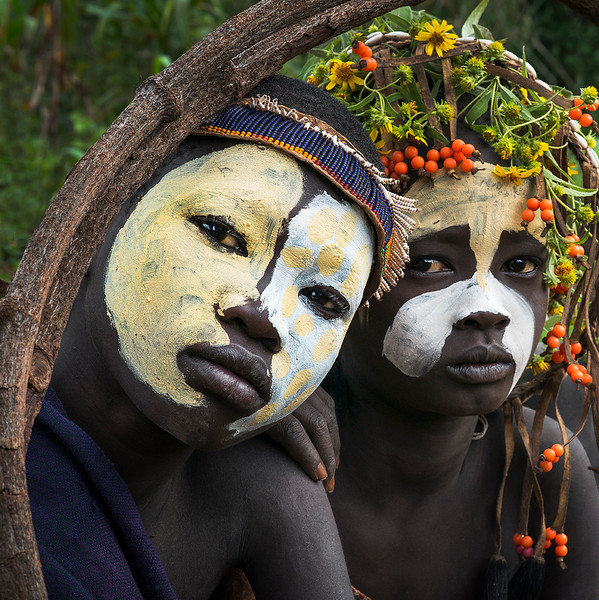 Two Suri boys with facial decoration posing for a photo.<br /> <br /> Southern Ethiopia, 2017.