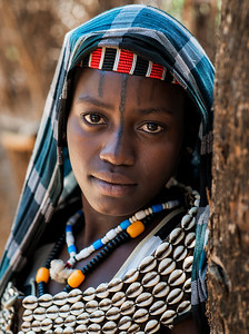 Portrait of a young Benna woman with face tattoo. This tattoos are not very common in this particular tribe.  Omo Valley, Ethiopia, 2017