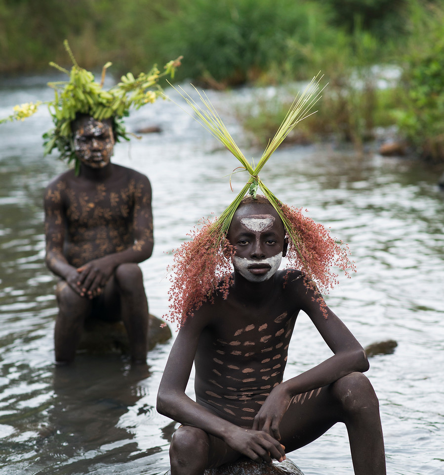 Two young Suri men by the river.<br /> <br /> Southern Ethiopia, 2017.