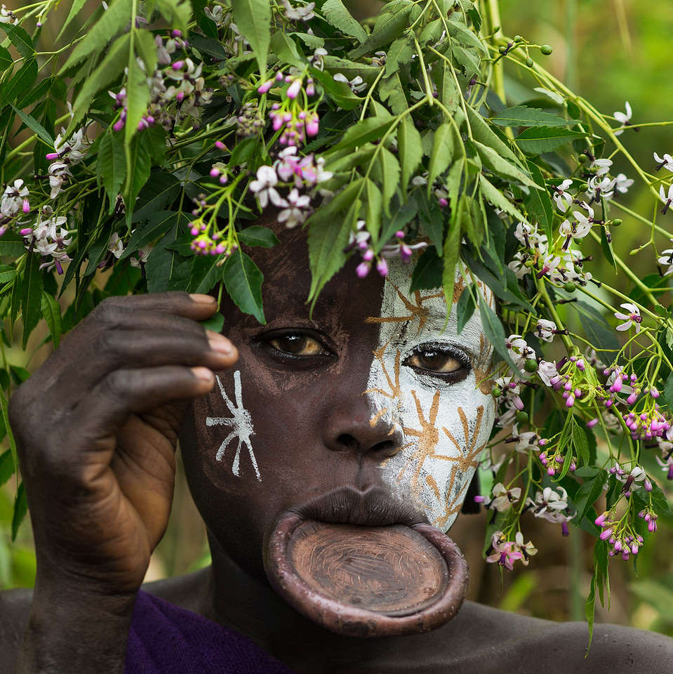 A Suri woman wearing the traditional lip plate and body paint.<br /> <br /> Southern Ethiopia, 2017.