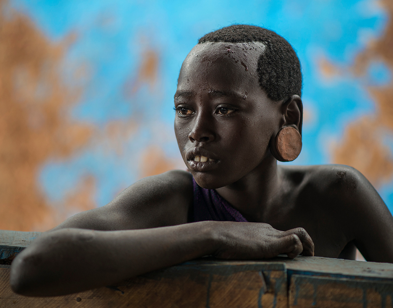 Portrait of a young Suri girl.<br /> <br /> Kibish, Southern Ethiopia, 2017.