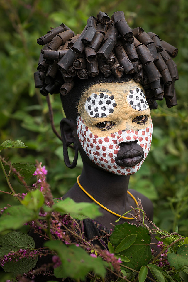 A young Suri woman with face painting.<br /> <br /> Southern Ethiopia, 2017
