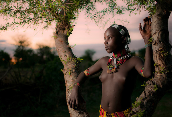 Young, single Hamar girl at Sunset.  Omo Valley, Southern Ethiopia, 2013.