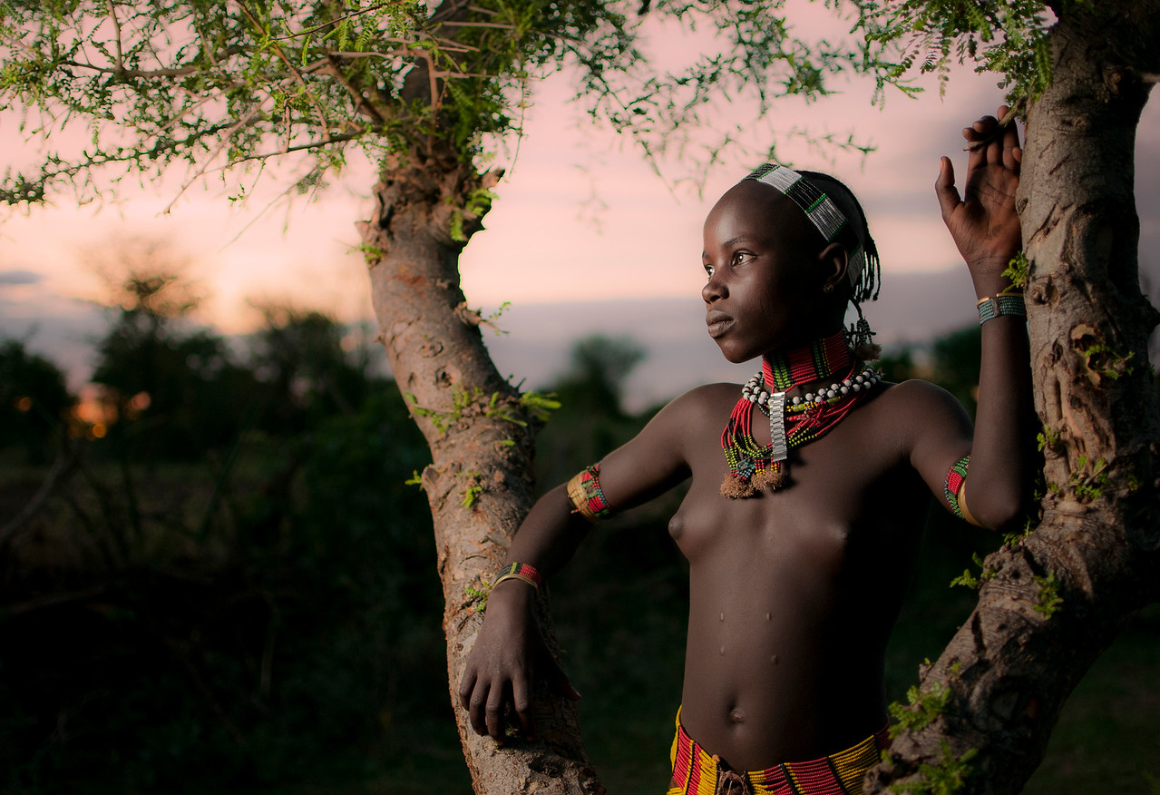 Young, single Hamar girl at Sunset.<br /> <br /> Omo Valley, Southern Ethiopia, 2013.