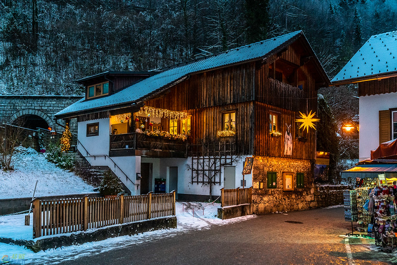 Beautiful Hallstatt decorated for the holidays all bright at night.
