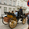 Horse drawn carriages speed by