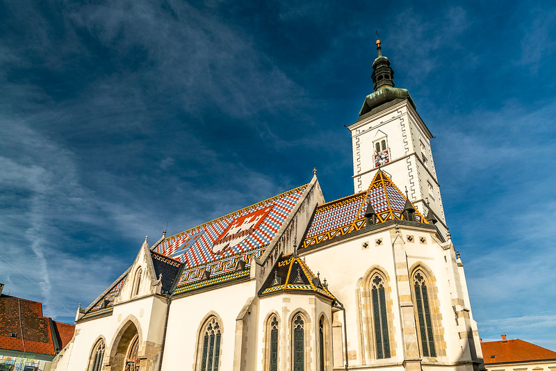 intereesting view of St. Marks church with the tile design on the roof.