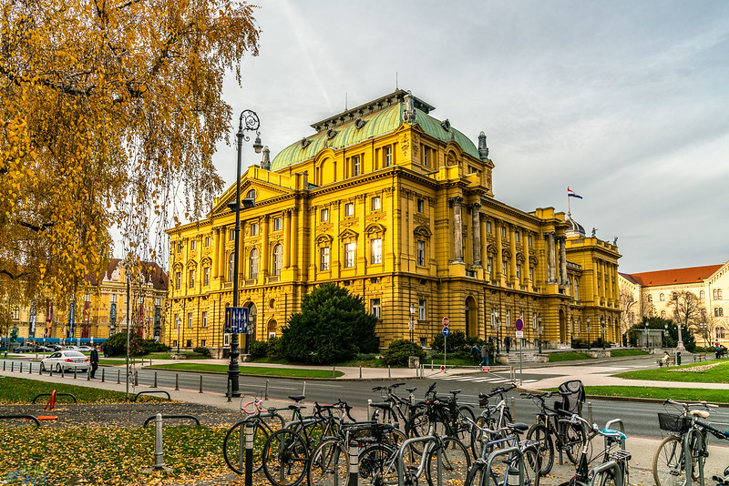 Golden colored Croatian national theater at sunset.