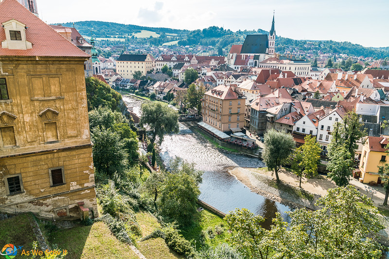 River flowing through the center of Cesky Krumlov, Czechia. One of the best day trips from Vienna.