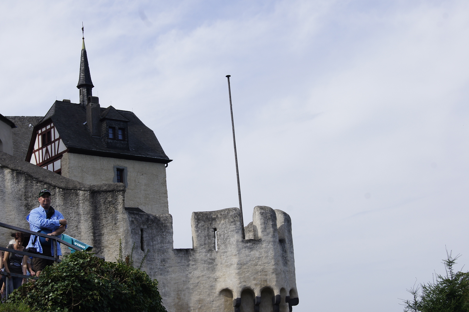 Marksburg castle, turret and balcony. Man stands in the foreground