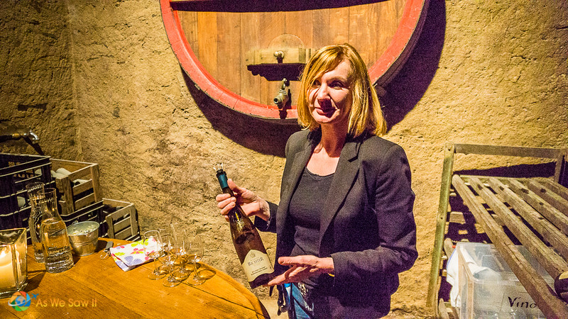 Woman at winery presents a variety of Mosel wine to visitors