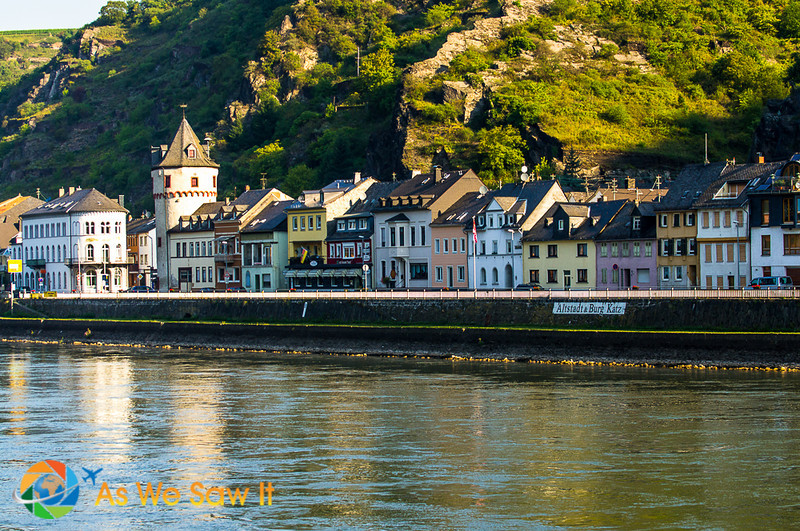German town along the Rhine, with railroad track on the bank.