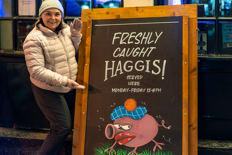 "Linda posing with a ""freshly caught Haggis"" sign"