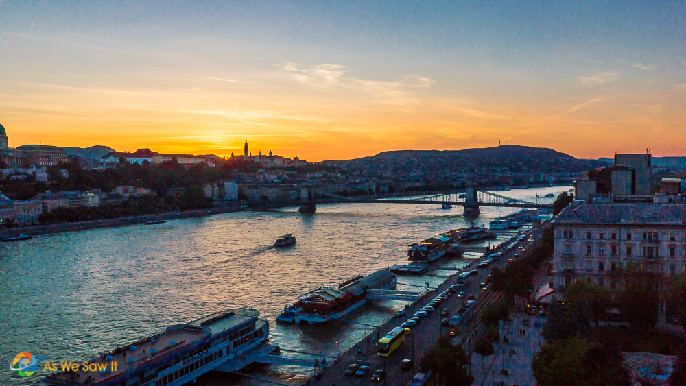 Cruise ships docked along the Danube in Budapest at sunset