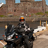 "Bill rides a V-Strom. Standing infront of the ancient castle, in Peel. Isle of Man. <a href=""http://www.motoquesttours.com/guided-motorcycle-tour.php?great-britain-isle-of-man-scotland-wales-uk-18"">http://www.motoquesttours.com/guided-motorcycle-tour.php?great-britain-isle-of-man-scotland-wales-uk-18</a>"