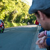 "The racers flyby at speeds of up to 206mph, just a few feet away from spectators at the Sulby Glen. some racers get that close they possibly suck the head off ya beer ! <a href=""http://bit.ly/isleofmanadventure"">http://bit.ly/isleofmanadventure</a>"