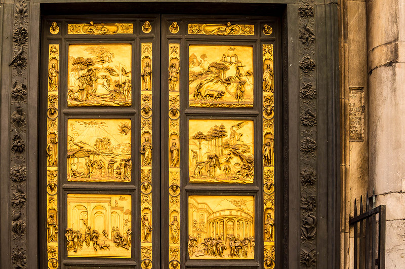 Bronze doors of St. John's Baptistery depicting Biblical scenes.