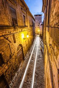 Headlight trails on an ancient street