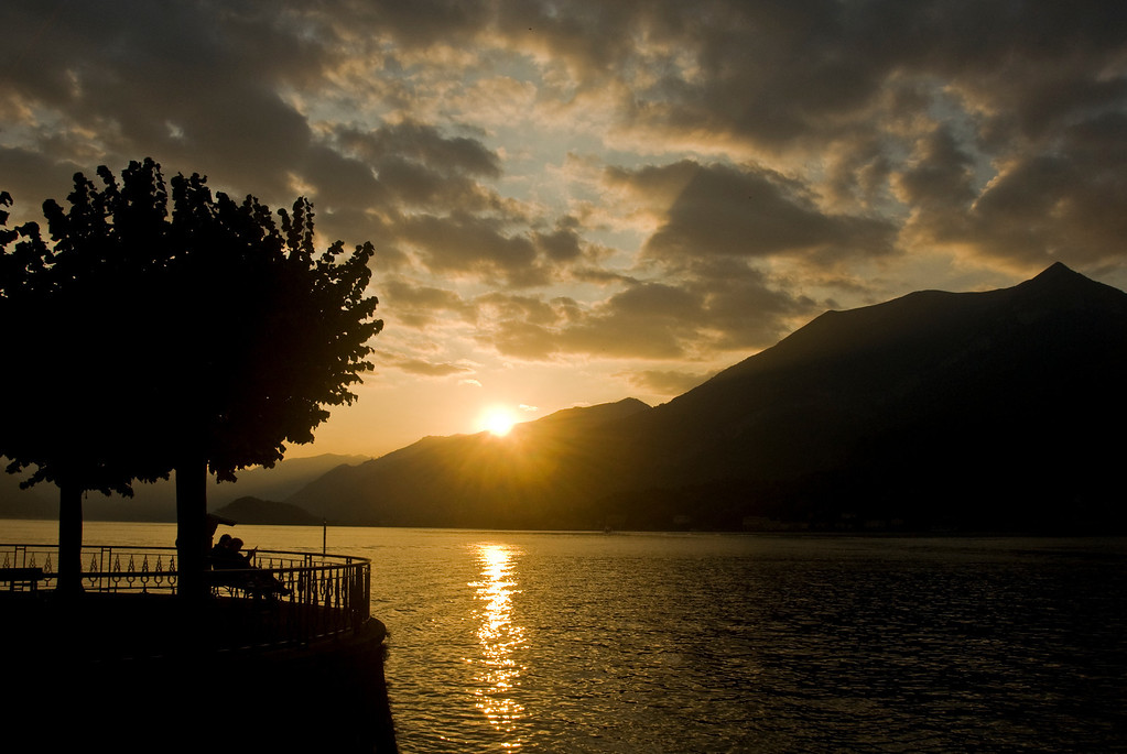 """""""A Peaceful Wishbone""""<br /> <br /> A couple enjoying the captivating sunset in Bellagio."""