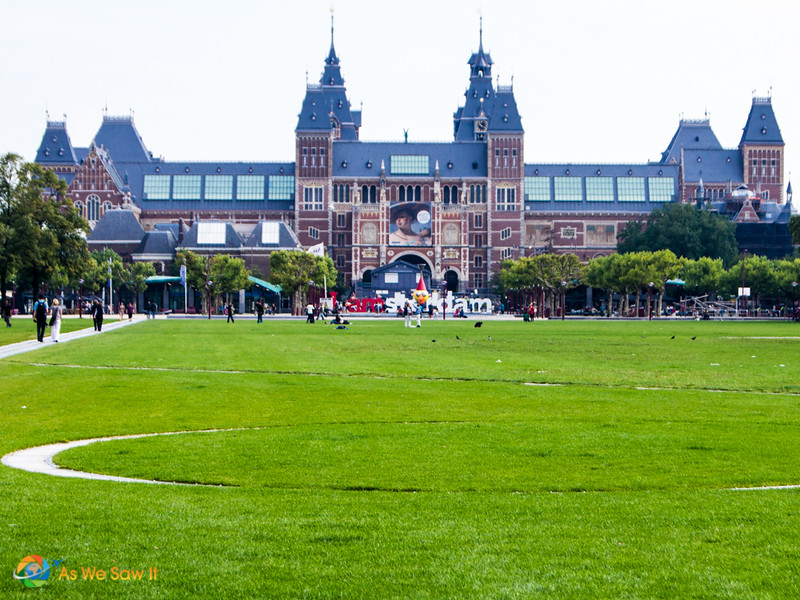 Brick front of Rijksmuseum, top Amsterdam museum, as seen from the grass on Museumplein.