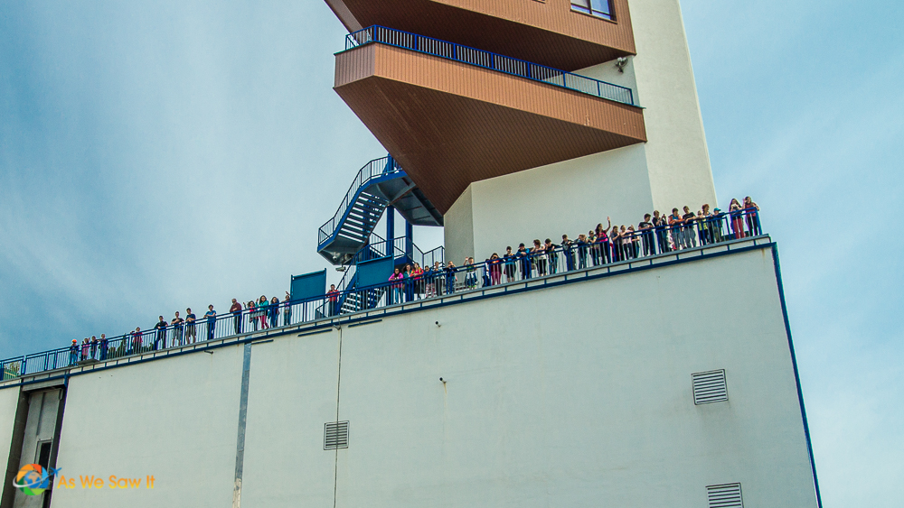 Shipside view of people watching our ship pass through a lock.