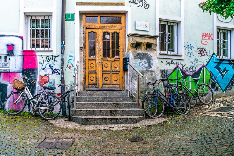 Bicycles and street art on side streets in ljubljana.