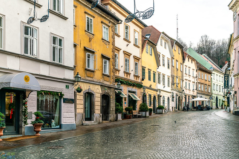 cobbled street with colorful buildings in old town ljubljana