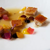 Iberian suckling pig blanquette with Riesling mango terrine, melon and beetroot, beetroot puree, black garlic, onion and orange concentrate.